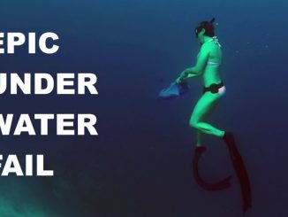 Epic Fail: Freediver Girl Doris hat Probleme mit einem Regenschirm. Screenshot von ihrem YouTube-Video.